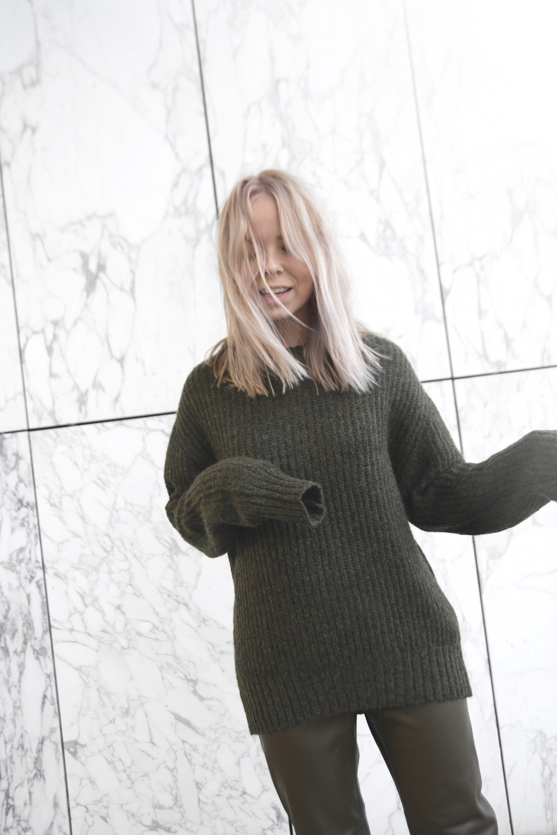 green knit sweater leather pants zara marble wall