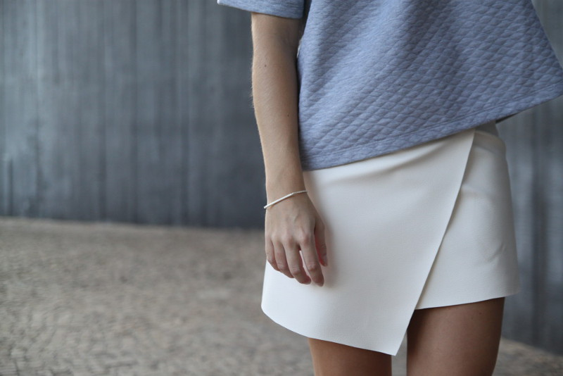 minimal fashion asymmetrical skirt leather quilted grey outfit
