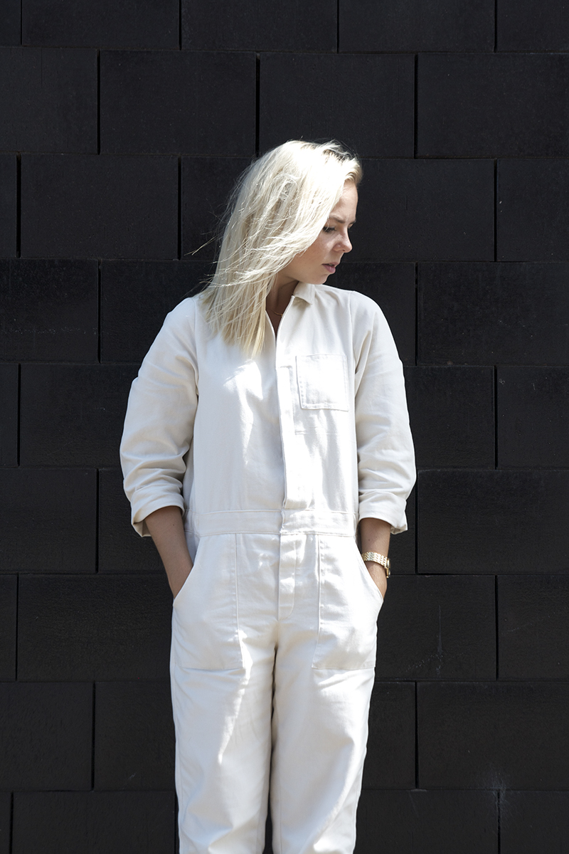 white overall utility jumpsuit cut out boots renard watch